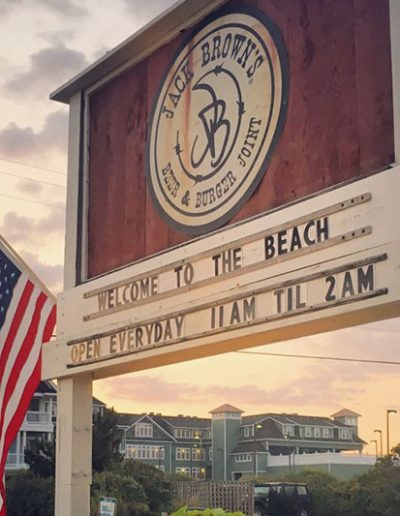 "The Jack Brown's Sign at Jack Brown's Kill Devil Hills, NC. It says ""Welcome the beach. Open everyday from 11 A.M. til 2 A.M."""