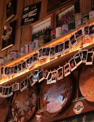 Polaroid photos of Notch Club members strung on the wall of Jack Brown's Beer and Burger Joint, Harrisonburg, VA.