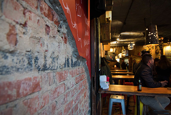 Brick wall, tables, and people enjoying drinks at Jack Brown's Richmond, VA.